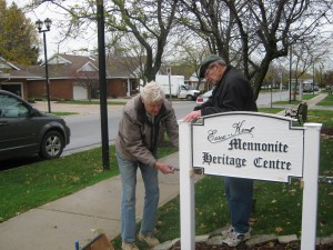 "Installing the ""Essex Kent Mennonite Heritage Centre"" sign"