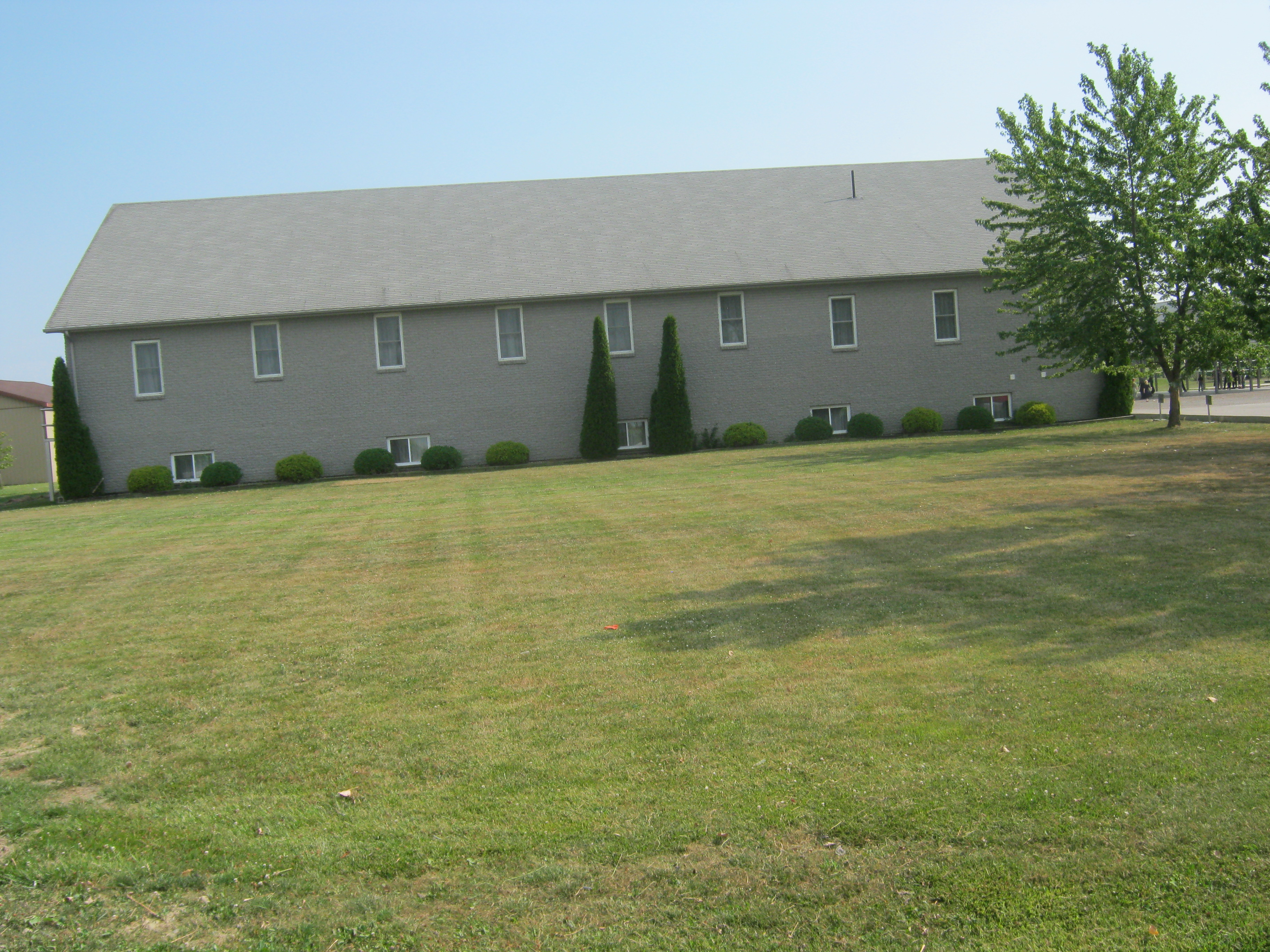 KIngsville Old Colony Mennonite Church with grass in front