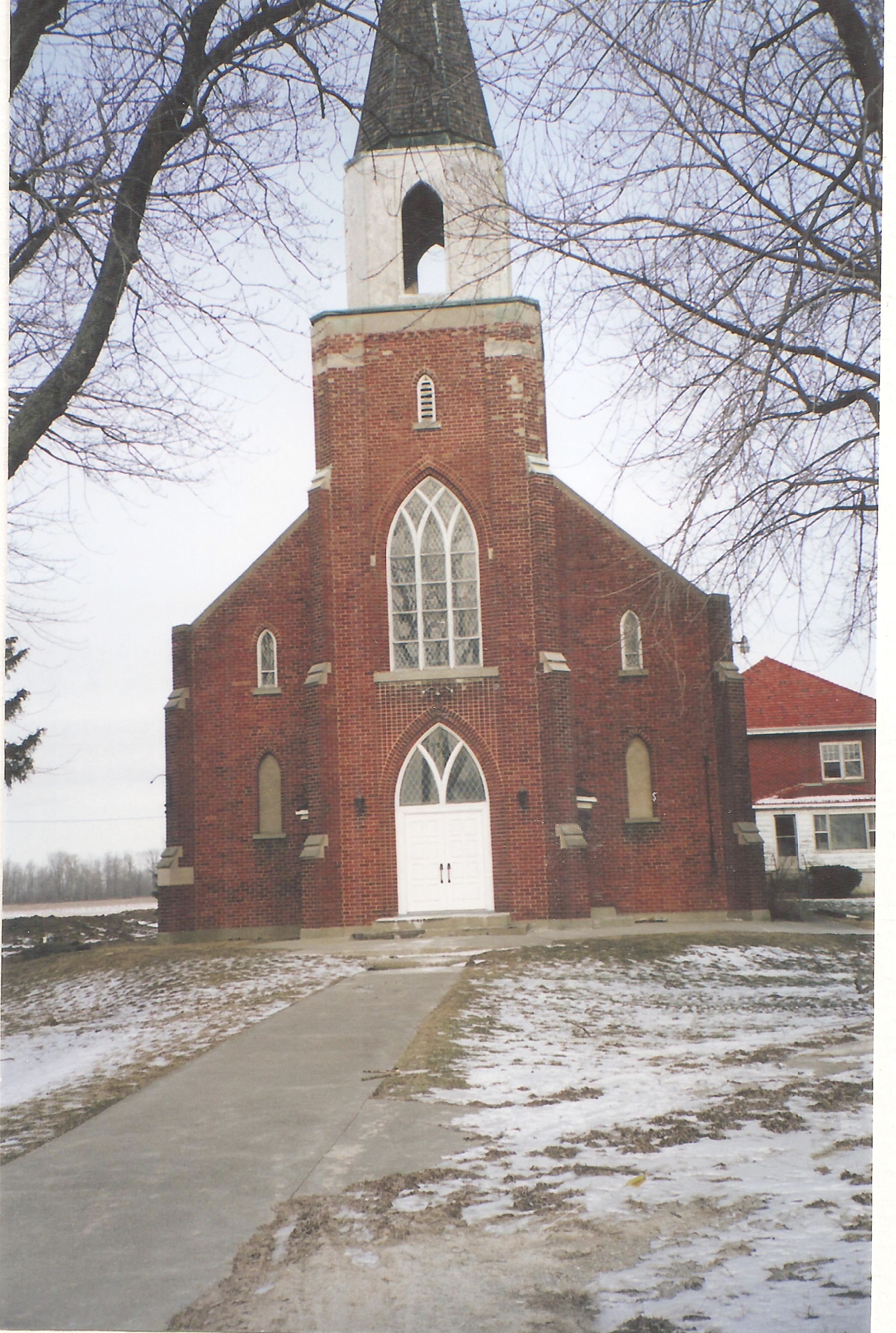 Red brick church with a tall steeple