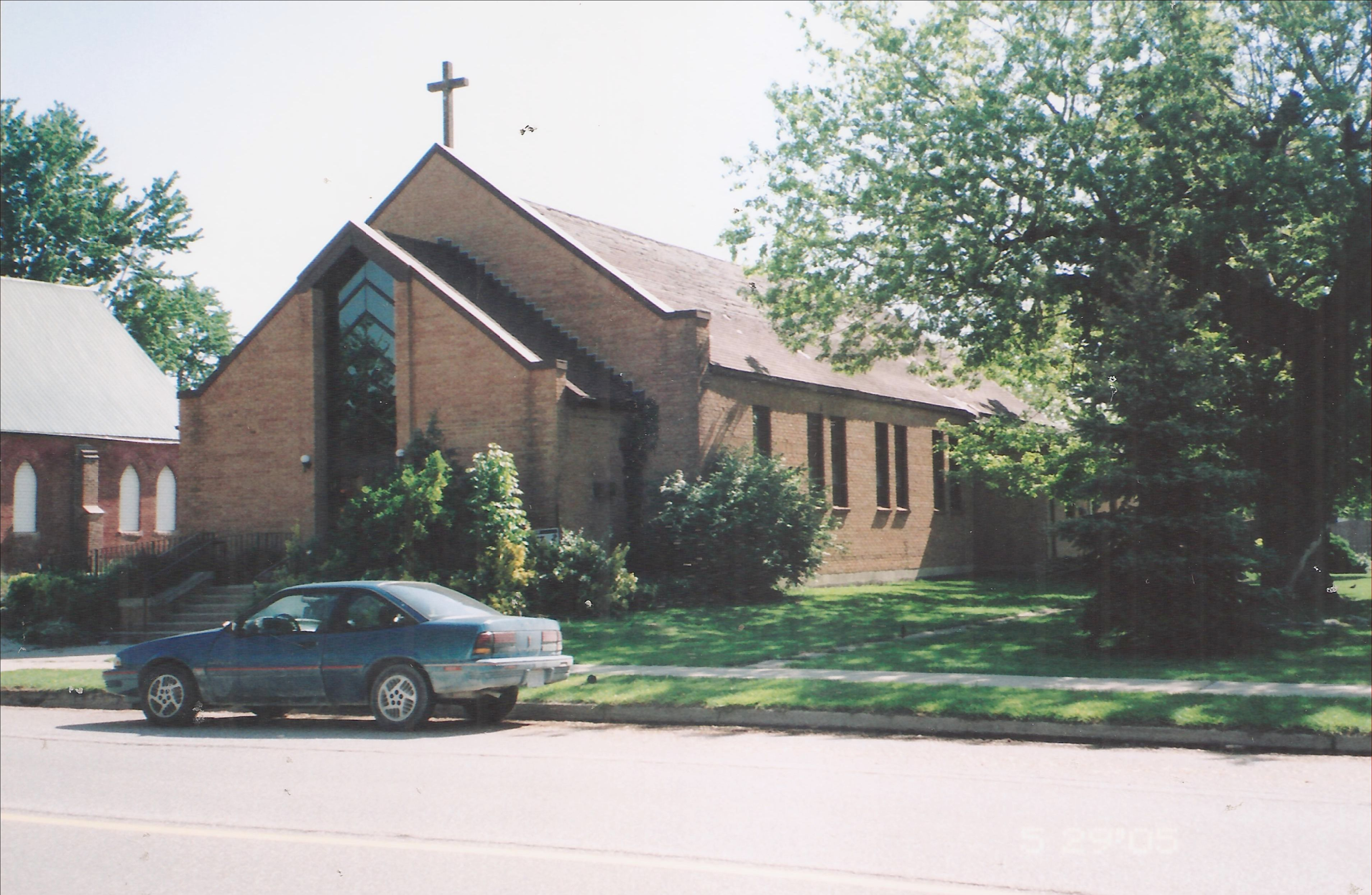 Red brick church with cross on top